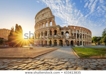 Coliseo Roma puesta de sol brillante Italia hierba Foto stock © Givaga