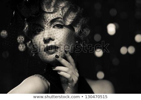 Gyönyörű nő fekete klasszikus ruha póz stúdió Stock fotó © prg0383