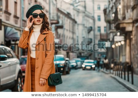 Woman in fashionable clothes and sunglasses Stock photo © Traimak
