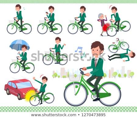 school boy green blazer ride on city bicycle stock photo © toyotoyo