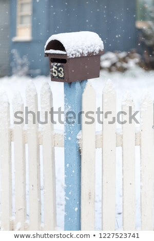 Snow covered picket fence in light falling snow Stock photo © lovleah
