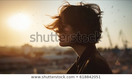 Portrait girl in sunset sky stock photo © Lopolo