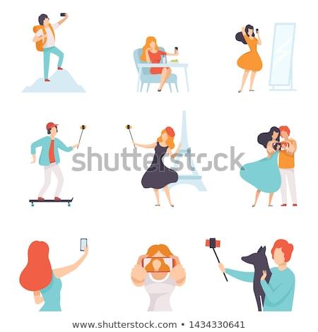 Blogger Woman Using Phone Taking Selfie Vector Stock photo © robuart