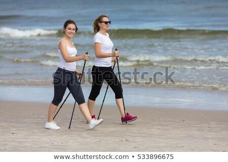 sétál · tenger · homok · nő · fehér · ruha · hát - stock fotó © kotenko