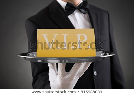 Waiter Holding Plate With Vip Banner Stock photo © AndreyPopov