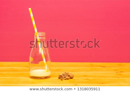 half bottle of banana milkshake with straw and cookie crumbs stock photo © sarahdoow