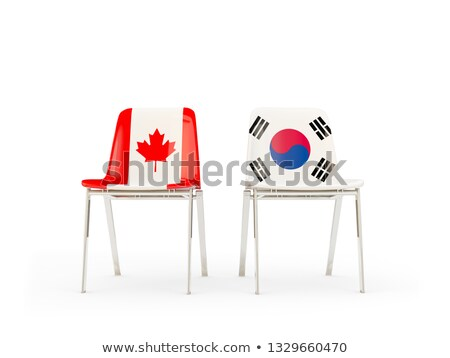 two chairs with flags of canada and south korea stock photo © mikhailmishchenko
