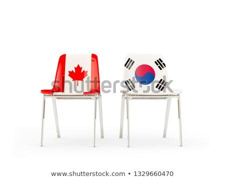 Iki sandalye bayraklar Kanada Güney Kore yalıtılmış Stok fotoğraf © MikhailMishchenko