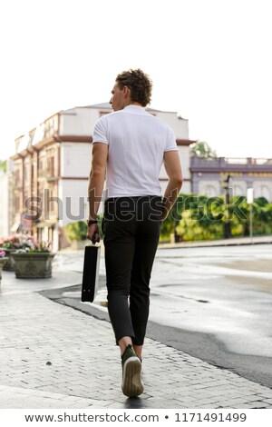 Widok z tyłu przystojny człowiek biznesu teczki spaceru Zdjęcia stock © deandrobot