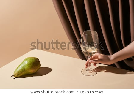 cropped image of woman holding glass of white wine stock photo © dashapetrenko