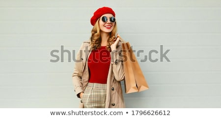 portrait of a cheerful casual young woman stock photo © deandrobot