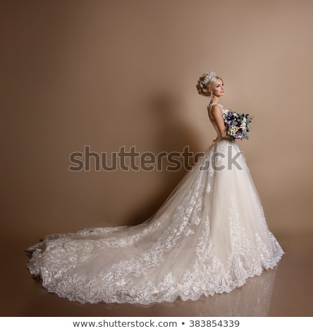 Silhouette of a young bride in a wedding dress with a bouquet in Stock photo © UrchenkoJulia
