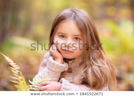 Head And Shoulders Of Young Girl In Autumn Woodland Stock photo © monkey_business