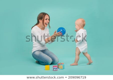mother and baby son playing with ball at home Stock photo © dolgachov