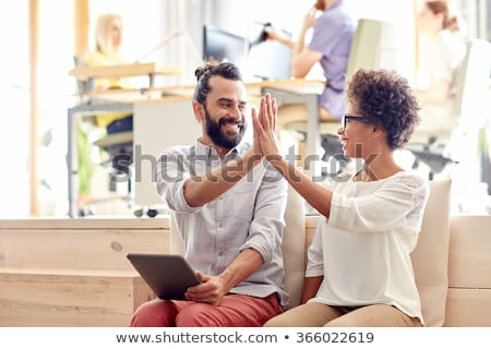 happy creative team making high five at office Stock photo © dolgachov