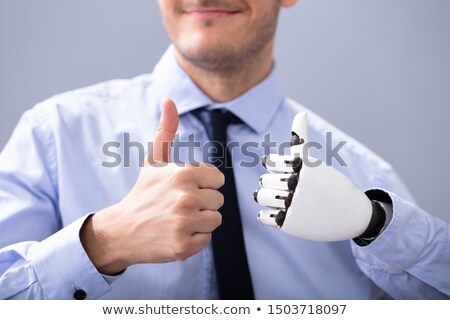 Businessperson With Prosthetic Limb Showing Thumb Up Stock photo © AndreyPopov