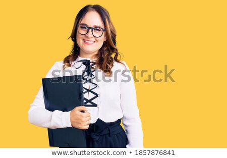 Elegant young female employee with toothy smile holding smartphone by ear Stock photo © pressmaster