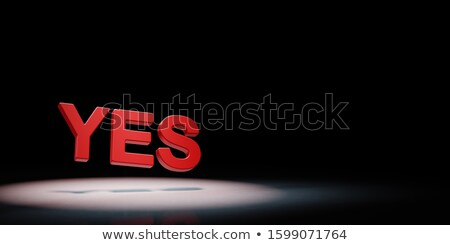 Yes Red Text Spotlighted on Black Background Stock photo © make