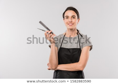 Pretty female hairdresser with scissors looking at you with toothy smile Stock photo © pressmaster