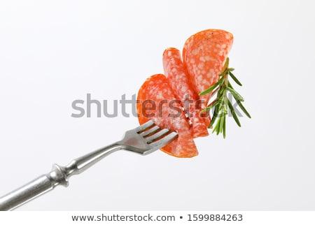 Delgado salami rebanadas romero tenedor húngaro Foto stock © Digifoodstock