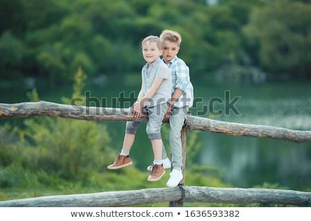 Two Boys Stand near Wooden Fence in Bavaria, Germany, Europe. Stock photo © ElenaBatkova