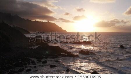 Fantastically beautiful sunset on the north coast of Tenerife, a beach with stones and black sand. Stock photo © ruslanshramko
