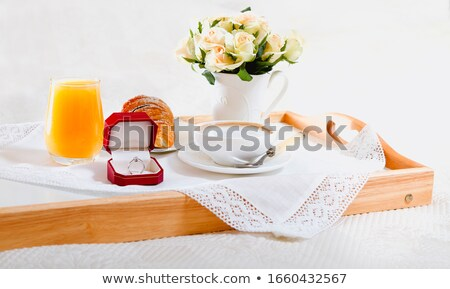 Wooden tray with breakfast and engagement ring Stock photo © dashapetrenko