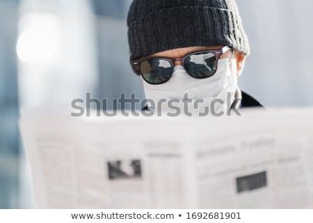 Tiro adulto hombre gafas de sol sombrero Foto stock © vkstudio