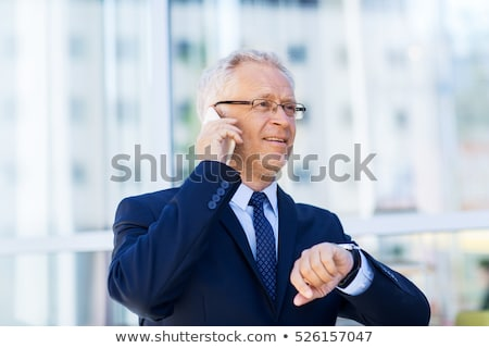 senior businessman calling on smartphone in city Stock photo © dolgachov