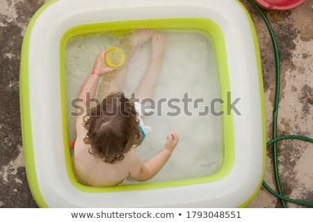 Feliz little girl diversão piscina inflável amarelo Foto stock © Illia