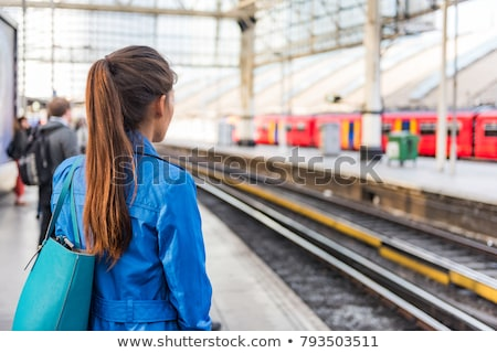 Train commuter woman going to work waiting for delayed tramway at station early morning panoramic ba Stock photo © Maridav