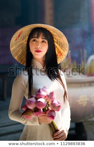 Jonge vrouw toeristische traditioneel hoed Vietnam business Stockfoto © galitskaya