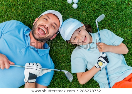 Lying man holds in mouth ball for golf Stock photo © Paha_L