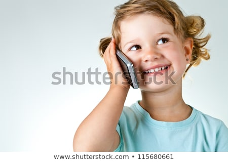 Stock photo: blue eyes child girl talking mobile phone