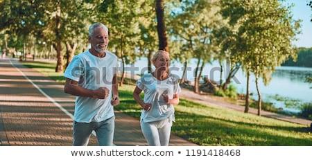 Kadın jogging açık havada orman güzel bir kadın gülümseme Stok fotoğraf © pekour