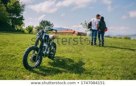 Stock fotó: Motorkerékpár · fű · pár · férfi · város · fal