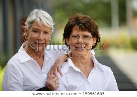 dois · senior · mulheres · em · pé · juntos · jardim - foto stock © photography33