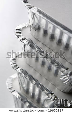 stack of foil take away containers stock photo © ozaiachin