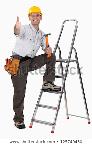 Carpenter stood by ladder giving the thumbs-up Stock photo © photography33