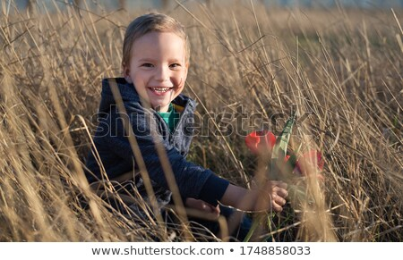 portrait of adorable young blonde outdoors with hands resting on bole Stock photo © photography33