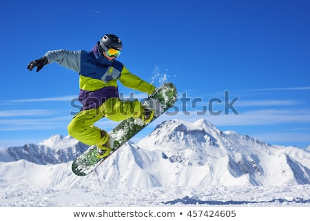 A snowboarder in mid-air Stock photo © photography33