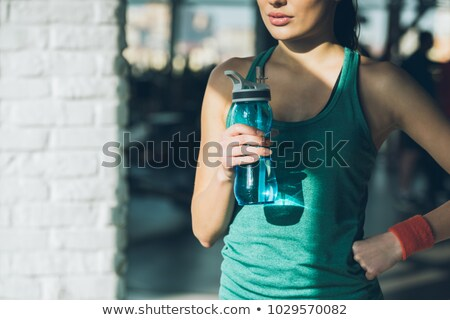 Attractive woman with a bottle stock photo © acidgrey