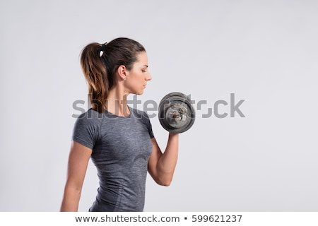 beautiful woman holding dumbell stock photo © chesterf