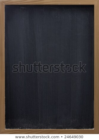 blank blackboard with vertical eraser smudges stock photo © pixelsaway