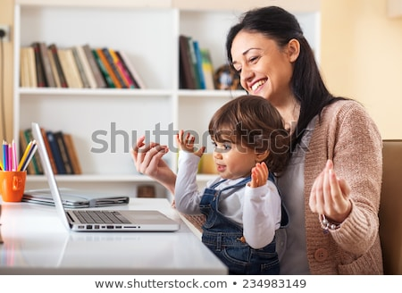 young mother and her child looking at a computer stock photo © philipimage