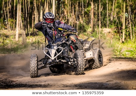 ATV racer takes a turn during a race.  Stock photo © homydesign
