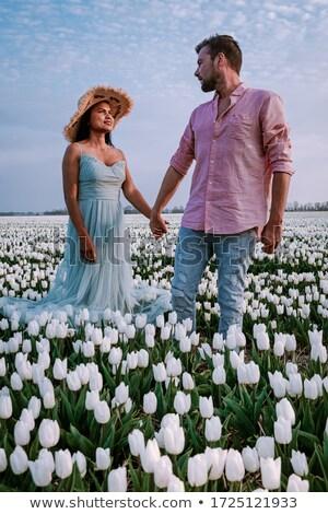 Cheerful couple posing with tulips Stock photo © majdansky