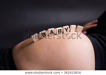 carta · caixas · mulher · grávida · barriga · bebê · mãe - foto stock © konradbak