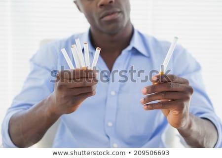 Człowiek elektronicznej normalny papierosów biuro projektu Zdjęcia stock © wavebreak_media