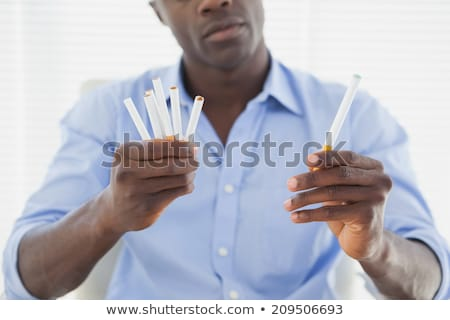 man deciding between electronic or normal cigarettes stock photo © wavebreak_media